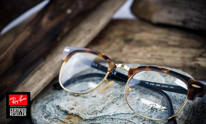 ray-ban glasses of the browline style on a table