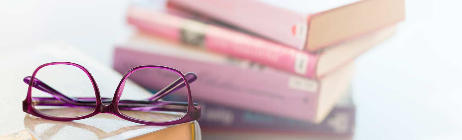 books and glasses on a table