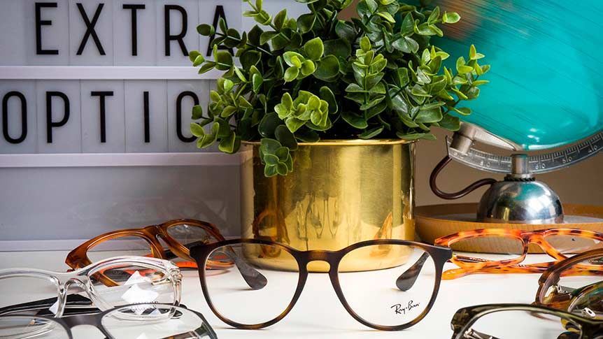 multiple pairs of designer glasses on a table