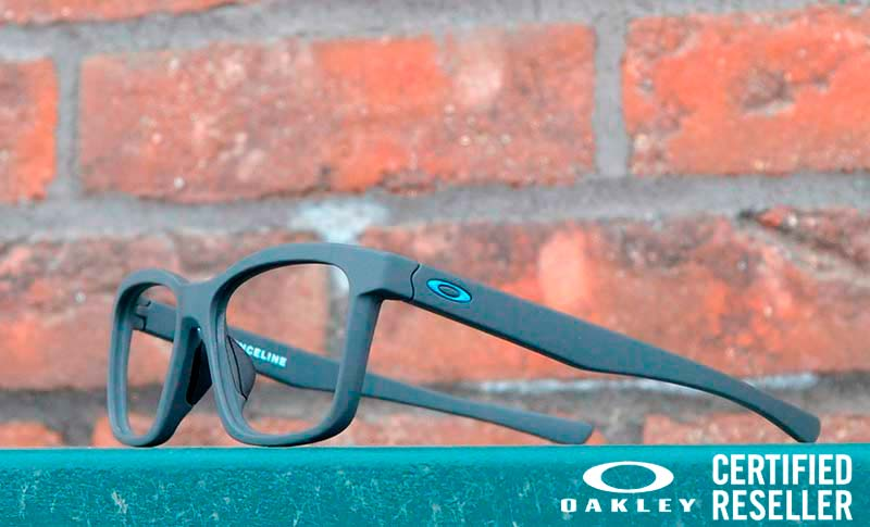 glasses on a board with a brick wall in the background