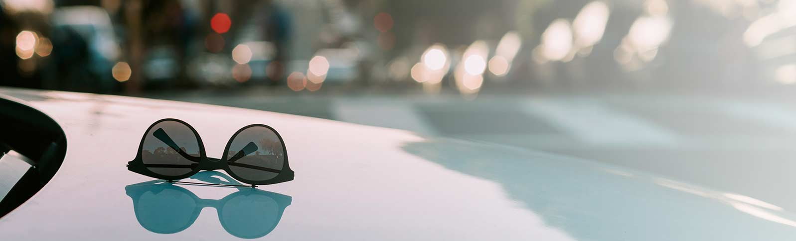 sunglasses on a car dashboard