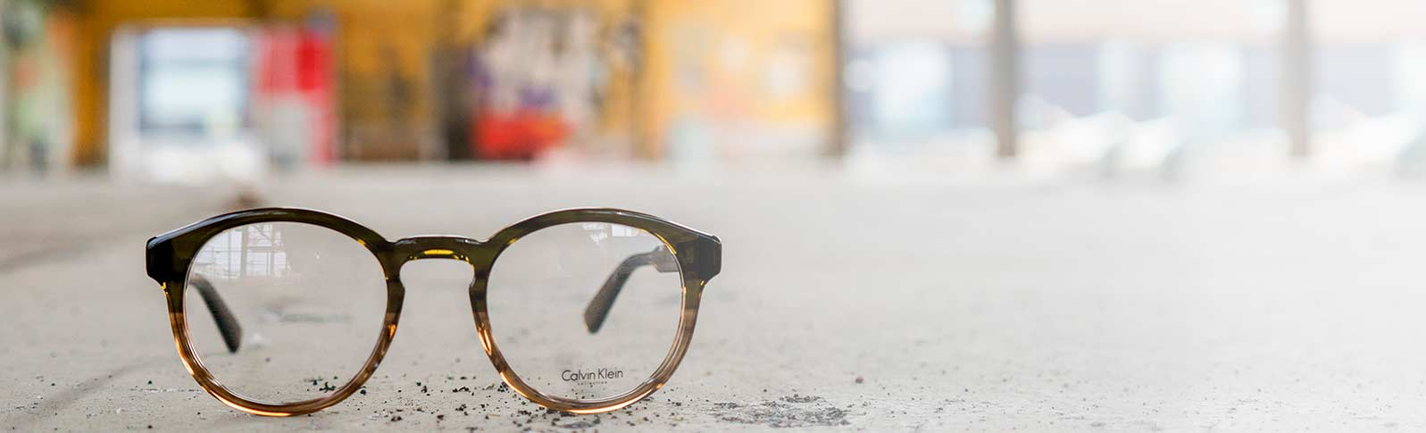 glasses from calvin klein in an industrial environment