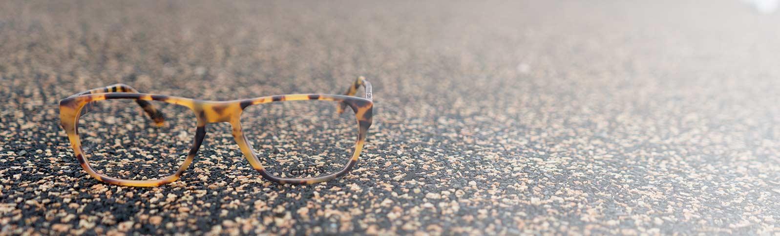 guess glasses on asphalt