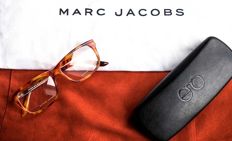 glasses from mark jacobs and an eyeglass case from extra optical on a table