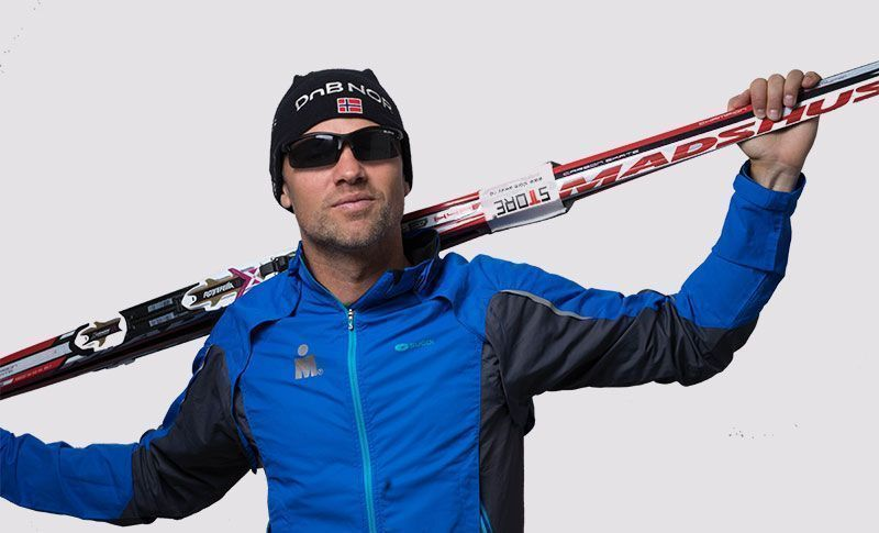 man wearing sports glasses with skis